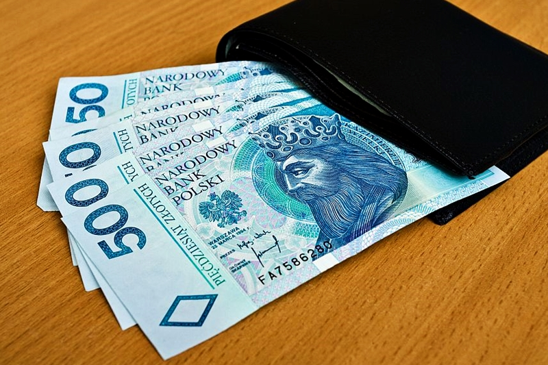 polish money - zloty, banknotes and wallet on the table
